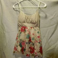 Floral Flowy Top Beautiful beige colored ruched top with a pink and blue floral flowy bottom. There are loops under the bust area for a wide belt, however I do not have a belt to go with it. Rue 21 Tops Tank Tops