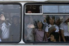 Commuters ride on a bus in Pyongyang, North Korea, Tuesday morning, June 25, 2013. (Photo by Alexander F. Yuan/AP Photo)
