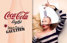 """Jean Paul Gaultier :directeur artistique pour Coca-Cola Light. Il donne le coup d'envoi de son partenariat exclusif avec la marque ce soir à Paris. Les bouteilles représentent l'attachement de JPG à la marinière et aux corsets. Afin de compléter la collection, une troisième bouteille sera lancée dans le courant de l'année. Son design unique 'Tattoo' évoquera l'amour que porte Gaultier à l'art corporel et viendra compléter le duo """"Night & Day"""""""