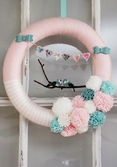 A DIY lovebird wreath set against a an old wooden window backdrop. So adorably cute!