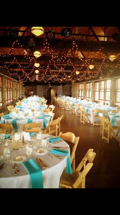 My Venue! The Towers, Narragansett , Rhode Island.  I opted for the simple white table linens, turquoise napkins ,pillar candles with sand for my centerpieces & natural wood chairs to round out my relaxed, simple beach theme :)