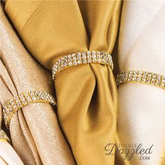 """PRODUCT OVERVIEW INSPIRATION CUSTOMIZATION Measurements Inches (Approx): 2"""" diameter Stones: Grade A+ CLEAR Glass Rhinestone Crystals Construction:Stretch Loop Metal Plating Color:Gold  Inspiration Coming Soon! Customization Coming Soon!"""