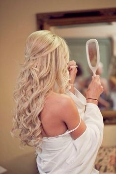 Long blonde half up do curls.