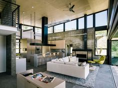 Modern Butterfly House immersed in a dramatic landscape