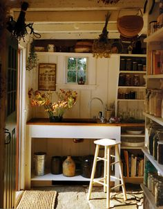 this little country kitchen would work perfect for a gardening center! Minus the stove and such of course,
