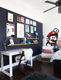 "Drawn to dark walls, but think ""no way!"" for a child's room? How about just one dark wall then? It brings a touch of drama, a hint of moodiness and an ounce of glam without the commitment of painting a whole room. Not convinced? Here are 15 examples of black and navy accent walls in nurseries in kids rooms to try to change your mind:"