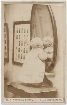 Ca. 1855-95, carte de visite portrait of a baby standing kissing his reflection. #victorian #photograph