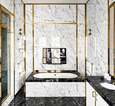 Marble and brass make a perfect pair in this luxurious bath. Photo by @thefacinator