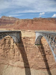 The Navajo Bridges are near-twins over the Colorado River's Marble Canyon in Arizona, 464 feet high. The original bridge was completed in 1929 and is open to pedestrian and equestrian traffic, while its newer counterpart was opened in 1995 and carries U.S. Route 89A