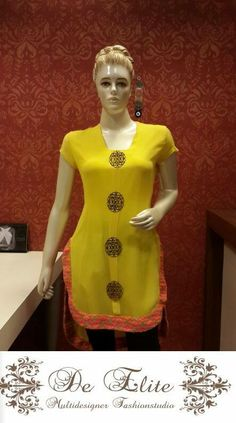 Wonderful Yellow tunic with golden buttons specially made by the designers for this outfit. The Uneven length of this tunic makes it very classy adorned with beautiful neon handloom lace at the bottom, something you cant go wrong with.....