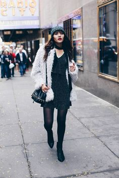 @natalieoffduty has the perfect holiday party look with our faux fur coat & metallic dress. Add tights and a beanie for chilly nights.