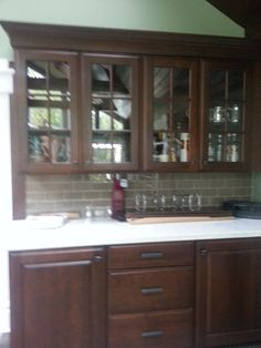 Omega Cabinetry, Bar cabinets,  Cherry cabinets, Silestone countertop, glass wall cabinets,  CK Kitchen & Bath Design, Inc.