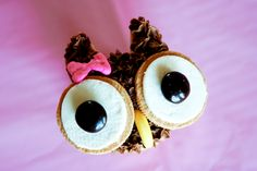 this is an owl cupcake with frosting and 2 open vanilla (like white oreos) cookies for the eyes with 2 brown m&m's and a runt banana as the beak, but I think it would be cute if it was done as a cocoa crispies rice crispy treat instead. and just use extra marshmallow to stick on the eyes.