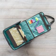 The Hanging Traveler Case is at the top of my wish list. I'll probably get five! I want one for me and one for each of my kids. Look at the pics and you can see how many different uses you can find for them - so much more than just a toiletry bag! I am going to use them to hang from the seat backs in the car, so each child can have their own little set of toys, coloring supplies, scrapbook supplies, etc. right in their space during our summer road trips.   Well, actually, I might have to…