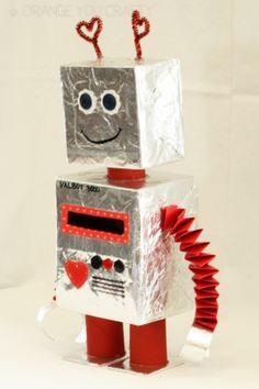 Orange You Crafty - Valentine Robot Orange You Crafty – Valbot Robot Valentine Mailbox side Recycled Robot, Recycled Crafts Kids, Diy Crafts For Kids, Projects For Kids, Art For Kids, Cool Valentine Boxes, Valentines Robots, Valentine Crafts, Cardboard Robot