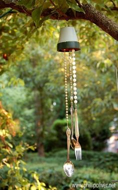 Homemade wind chimes hanging from the trees!