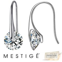 Shadora.com  Mestige Crystal Eclipse Earrings made with Swarovski Elements  $11.99    GemstoneSwarovski Elements  MetalRhodium Plated  Dimensions12mm (Diameter)  PackagingJewelry Gift Box