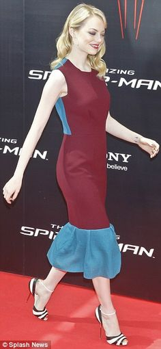 Careful! The Amazing Spider-Man star Emma Stone totters along the red carpet in tight dress and heels but still looks fantastic