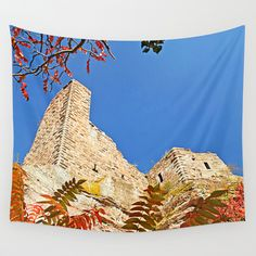 Autumnally castle Wall Tapestry Photography of a castle ruin in my homeland, the Palatinate in Germany. The leaves are from staghorn sumach, which grows in masses along one side of that big ruin. Here's an  edited version of this photo: http://society6.com/pirminnohr/thunderstorm-castle#1=45  blue sky, orange, red, historical building, autumn, fall, Dahn, Grafendahn, Pfalz, architecture, medieval