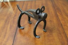 Horseshoe Dog. Railroad Spike Dog. Hammer Head Dog.