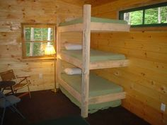 Triple bunk bed! Perfectly simple. Could add a shelf or two per bunk for their own private things.