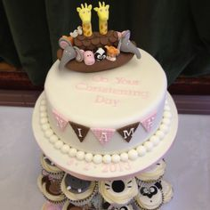 Noahs Ark themed Christening cupcake tower by www.candyscupcakecakes.co.uk