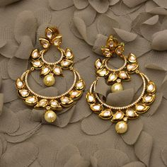 A double chand baali earring design with leaf shaped stud and yellow pearl drops! Indian Jewelry Earrings, Jewelry Design Earrings, Indian Wedding Jewelry, Designer Earrings, Bridal Jewelry, Jewelry Art, Fashion Jewelry, Silver Jewelry, Fashion Necklace