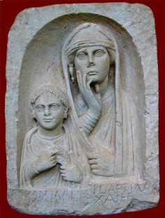 """Roman funerary relief of a woman and daughter, from Syria (1st century CE) -- The Greek inscription reads: """"Mimia, too soon, farewell; Koartilla farewell"""" The mother wears native Mesopotamian costume; the daughter holds a wreath and wears fashionable Roman jewelry.  On display at Museum of Fine Arts, Boston."""