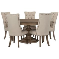 Includes: Round dining table and four upholstered chairs  Put classic design on a pedestal with the Haddie round dining set. With an impressive turned base that celebrates timeless beauty, this dining set is paired with nailhead-trimmed chairs with button diamond tufting.