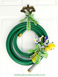 I Acutally Love This Garden Hose Wreath... What A Way To Brighten Up A Door On A Dreary Almost Spring Day & What A Cool Gift For The Neighbor Who's Always There For You...