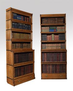 pair oak globe wernicke six section bookcases the moulded top above six graduated section all