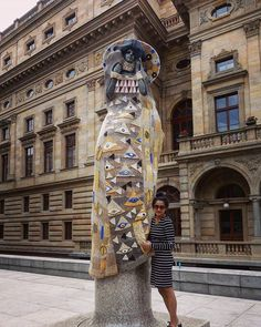 "Crocheted Klimt!  Czech costume designer Eva Bláhová draws inspiration from Klimt's #TheLadyInGold and I think she picked just the right sculpture to drape, not because it prominently sits at the entrace to the #NationalTheatre and beckons art lovers but because the crochet hangs over an interesting   socialist modernist sculpture titled ""Rebirth"" by Josef Malejovsky.   #VaclavHavelSquare #Prague #GustavKlimt #josefmalejovsky   I just wanted to get under it ☺"