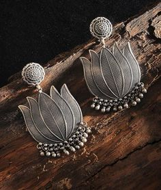 Buy Silver Moments Jewels India Silver earrings, jhumkis with floral, peacock and deity motifs Online at Jaypore.com