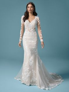 Francesca| Romantic illusion back sheath wedding dress with long illusion and lace sleeves. #wedding #weddingdress #weddingdresses #bride #bridalgown #bridal #weddingplanning #weddingfashion #maggiesottero