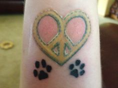 My new wrist tattoo. I copied the heart peace sign from my fav pair of cowboy boots. Then we added doggie paw prints.