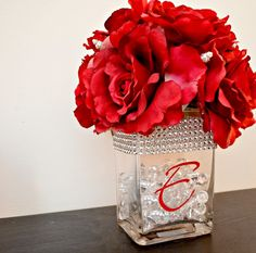 The Chic Technique: DIY Wedding Centerpiece David Tutera Red Roses. This would be pretty with blush flowers and lace instead of the bling Wedding Table Centerpieces, Flower Centerpieces, Wedding Decorations, Centerpiece Ideas, Graduation Centerpiece, Decor Wedding, Summer Centerpieces, Quinceanera Centerpieces, Vase Ideas