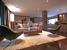 """""""Earthy tones combine this open space as living room, dining room and kitchen, giving a cozy ambiance."""" 