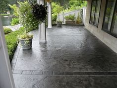For the new porch/driveway: Dolphin Grey Concrete Patios Narrows Construction Gig Harbor, WA