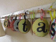 A fantastic way to reuse old CDs or DVDs - a 'Merry Christmas' sign.  This is great, especially since they are difficult to recycle.