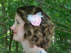 Petite, flower girl, pink facinator with shimmery organza and a pearl spray.