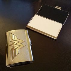 You won't need a theme song to let people know you're wearing tights and fighting for their rights… not when you flash them the Wonder Woman Business Card Holder! Featuring a glossy gold finish and em