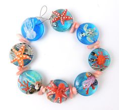 Ocean critters beads ready to become a bracelet. Corinabeads -Lampwork beads by Corina Tettinger