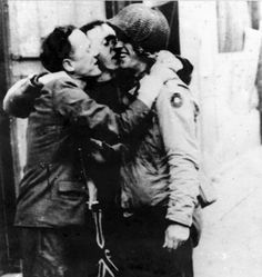 Two civilians of Cherbourg welcome (and more or less maul) an American soldier of the 9th US ID upon the liberation their town. #WWII