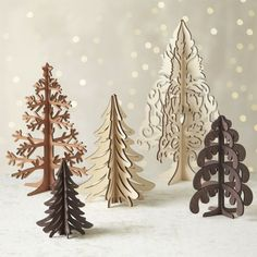 Graphic wood trees are laser-cut in realistic detail, easily assembled into dimensional, freestanding conversation pieces. Pieces assemble to create a modern, dimensional decoration great for table or mantel.<br /><br /><NEWTAG/><ul><li>Laser-cut plywood</li><li>Stores flat</li><li>For decorative use only; not a toy</li><li>Made in China</li></ul>