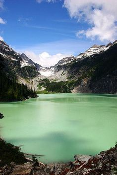 Blanca Lake in Washington is fed by the Columbia Glacier to the northwest. The glacier's cold, silt-filled melt water is what gives the lake it's unique, turquoise green color.