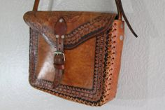 chic woven brown tooled leather sling purse