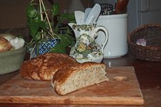 Rye bread on a hand made cutting board made by my son.Resting in the middle of my kitchen is an island I made from an old table. On top I store utensils, plants, onions and garlic and a cake stand. I still have enough room to roll out dough and make dinner.