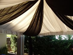 fabric draping marquee decorations instead of black & white crepe paper streamers