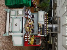 look how they decorated at a fruit stand this old stove...love it