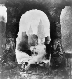 The western bell towers of St Pauls Cathedral in London seen through an archway after the heavy incendiary raid of 29 December 1940. -
